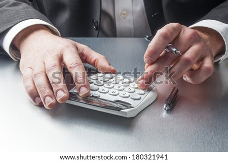 financial man counting and taking notes - stock photo