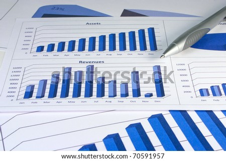 Financial management graphs in a corporate blue color - stock photo