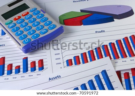 Financial management graphs with a calculator - stock photo