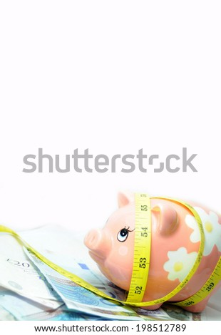 Financial metaphor of piggy bank and various currencies against white (copyspace available) - stock photo