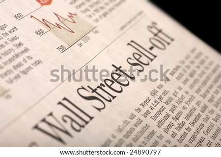 "Financial newspaper page with headline ""Wall Street sell-off"" - perspective view with shallow depth of field. - stock photo"