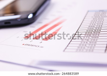 Financial or accounting concept - business chart, phone - stock photo