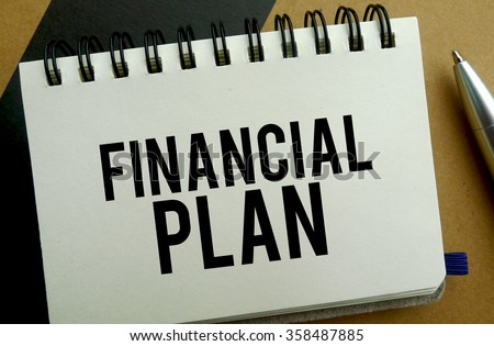 Financial plan memo written on a notebook with pen