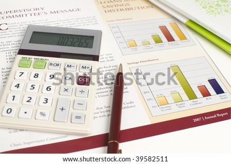 Financial Planning and Review of Savings Reports with Calculator, Pen and great color. - stock photo