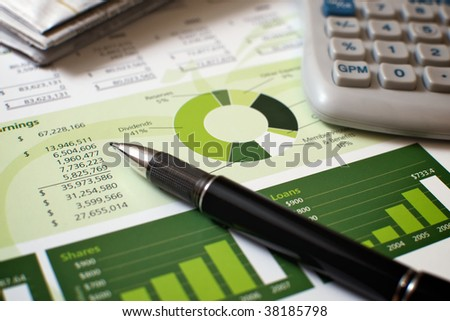 Financial Planning and Review of Year End Reports - stock photo