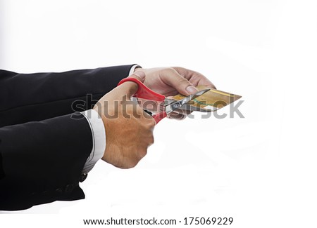 Financial Planning Concept-Executive Hand Cutting credit card over white backgound - stock photo