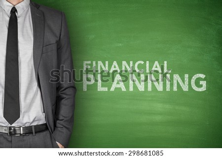 Financial planning text on green blackboard with businessman - stock photo