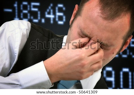 Financial problems. Businessman covering face in disbelief, stock exchange concept