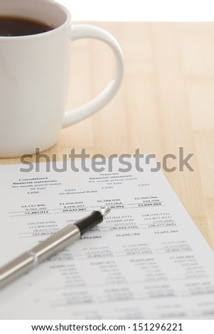 Financial report with calculator on table