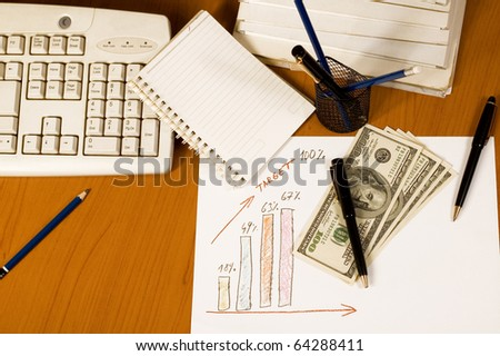 Financial report with graph and money - stock photo