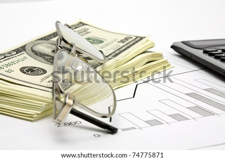 financial report with pen - stock photo