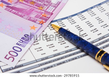 Financial report with pen and euro bank note