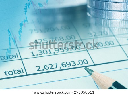 Financial reports , graph and coin. 