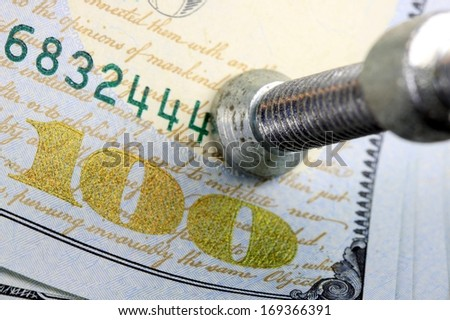 Financial Squeeze US currency one hundred dollar bills squeezed in a clamp vise  - stock photo