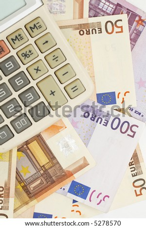 financial statement, calculator over euro banknotes - stock photo