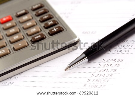Financial statement, pen and calculator
