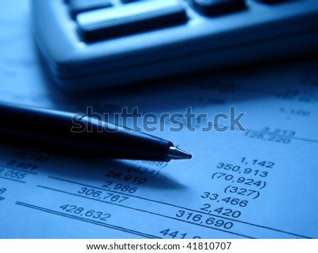 financial statement with calculator and pen (2) - stock photo