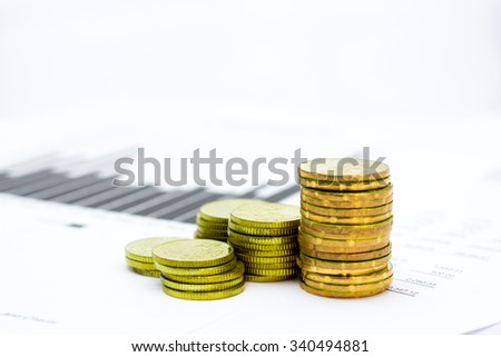 Financial statement with coins. (finance and business concept)