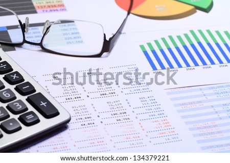 Financial statements review and analyze with colorful charts and tables. - stock photo