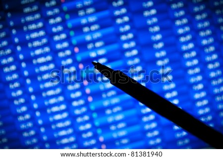 financial stats on computer screen. Spotlight effect, dramatic light - stock photo