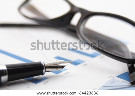 financial stock market success concept with chart and pen