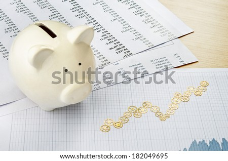 Financial strategy. Growth chart formed by clockworks - stock photo