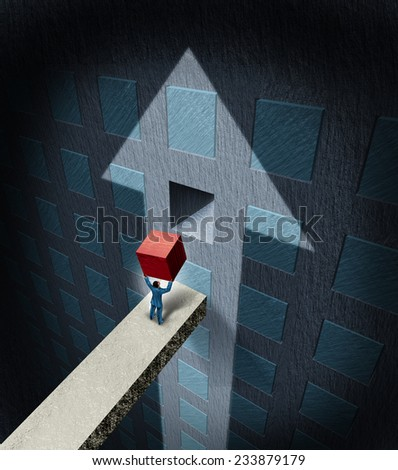 Financial success concept as a businessman lifting a heavy red cube to complete a wall puzzle shaped as an upwards arrow as a business wealth plan and profit strategy metaphor. - stock photo