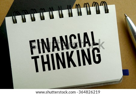 Financial thinking memo written on a notebook with pen