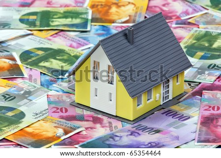 Financing a home in Swiss francs - stock photo