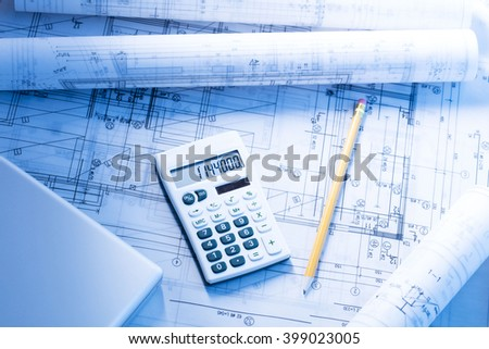 Calculator showing number on top house stock photo for Blueprint estimator