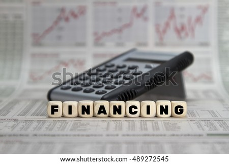 Financing word on a business newspaper