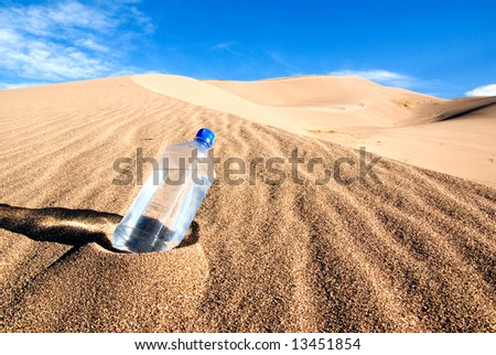 Find a cool drink in the middle of a desert - stock photo