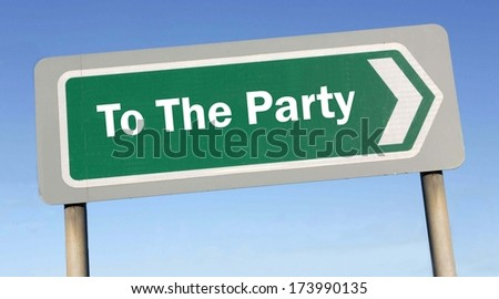Find a fun party and follow the road sign against a blue sky background - stock photo