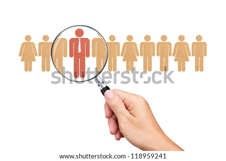 Find an employee with a magnifying glass - stock photo