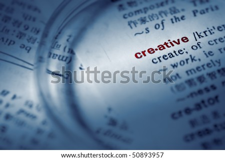 Find creative definition from book by magnifier. - stock photo