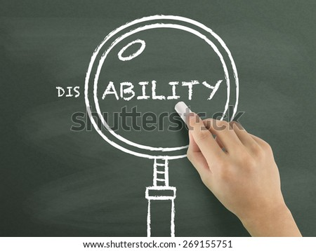 find out ability with magnifying glass drawn by hand over chalkboard  - stock photo