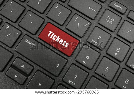 Find tickets concept, laptop keyboard with tickets button
