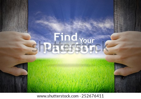 Find Your Passion Motivational quotes. Hands opening a wooden door then found a texts floating among new world as green grass field, Blue sky and the Sunrise. - stock photo