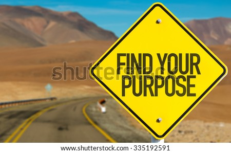 Find Your Purpose sign on desert road - stock photo