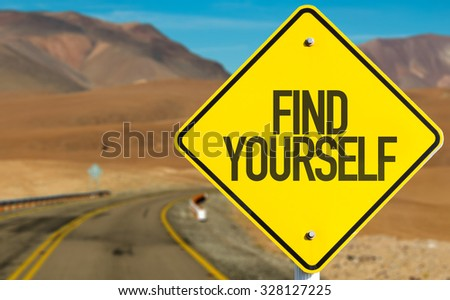 Find Yourself sign on desert road - stock photo