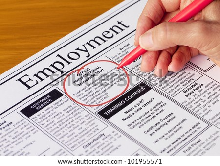 Finding a job in the employment section of the newspaper (newspaper created by photographer) - stock photo