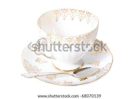 Fine antique china and silver spoon - stock photo