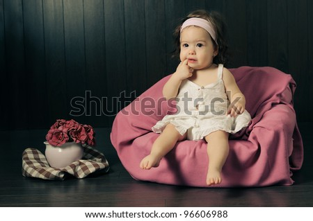 Fine art baby girl portrait. Processed to give a vintage look. - stock photo