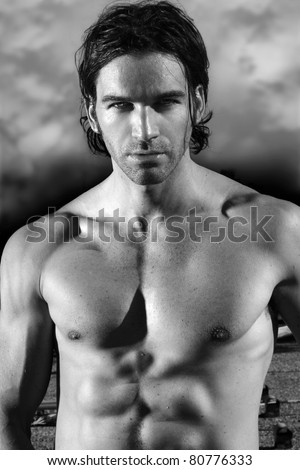 Fine art black and white portrait of a beautiful shirtless male model - stock photo
