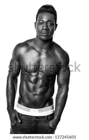 Fine art black and white portrait of a muscular male model. - stock photo