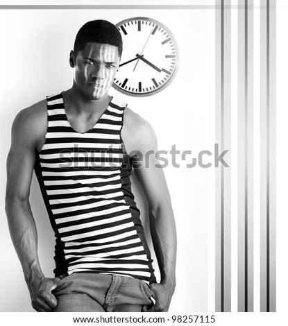 Fine art high contrast black and white photo of a male model with abstract retro clock and stripes against white modern background - stock photo