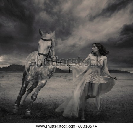 Fine art photo of a young beauty running with a horse - stock photo