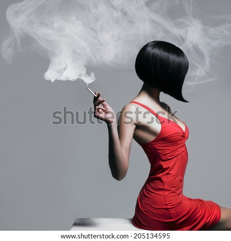 Fine art portrait of a beautiful lady with cigarette - stock photo