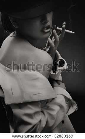 Fine art portrait of a beautiful lady with cigarette - b w version - stock photo