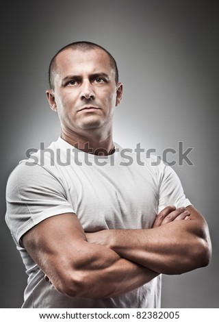 Fine art portrait of a menacing man, studio close up - stock photo